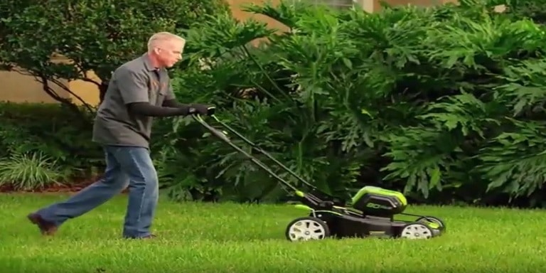 How does an electric lawn mower work